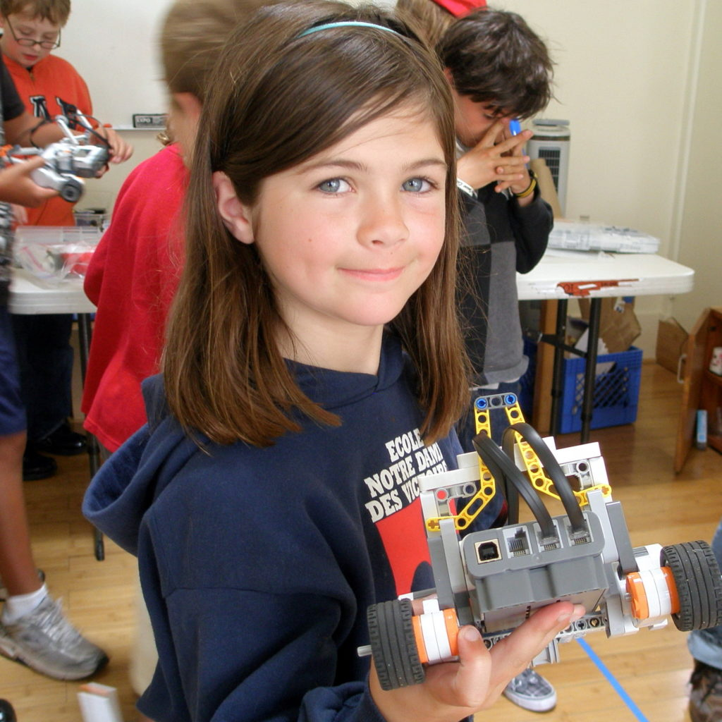 A girl with camera build from Lego in the lego camp bay area